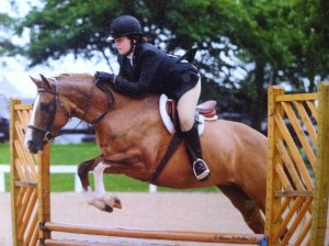 Student Brenna competing with her horse, Aspen